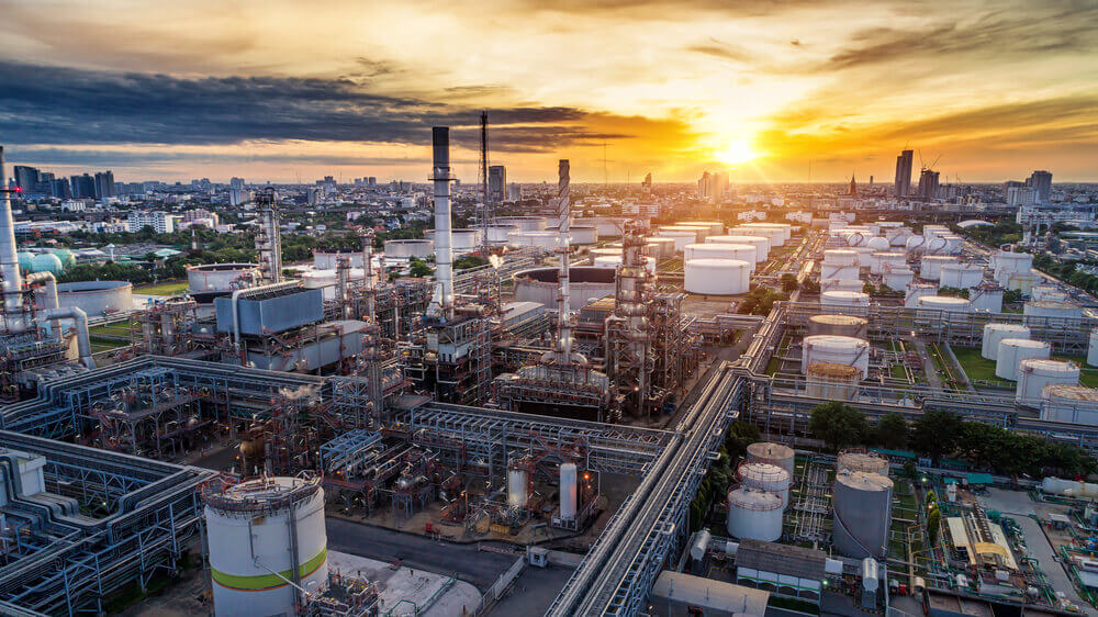 Aerial view of Oil and gas industry, refinery at sunset, factory and petrochemical plant.