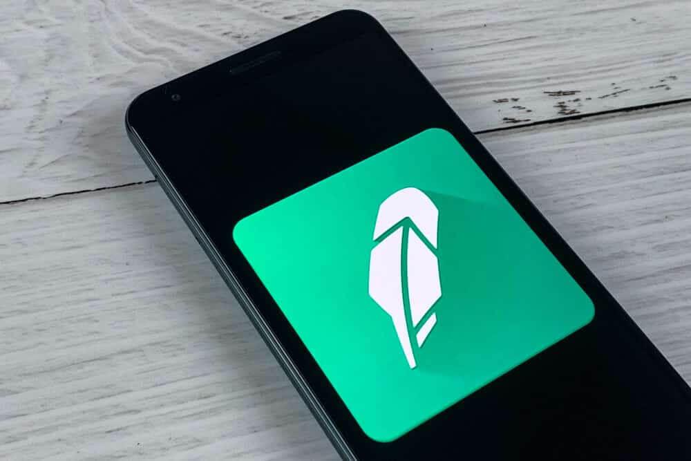 Smartphone showing Robinhood application logo on a screen.