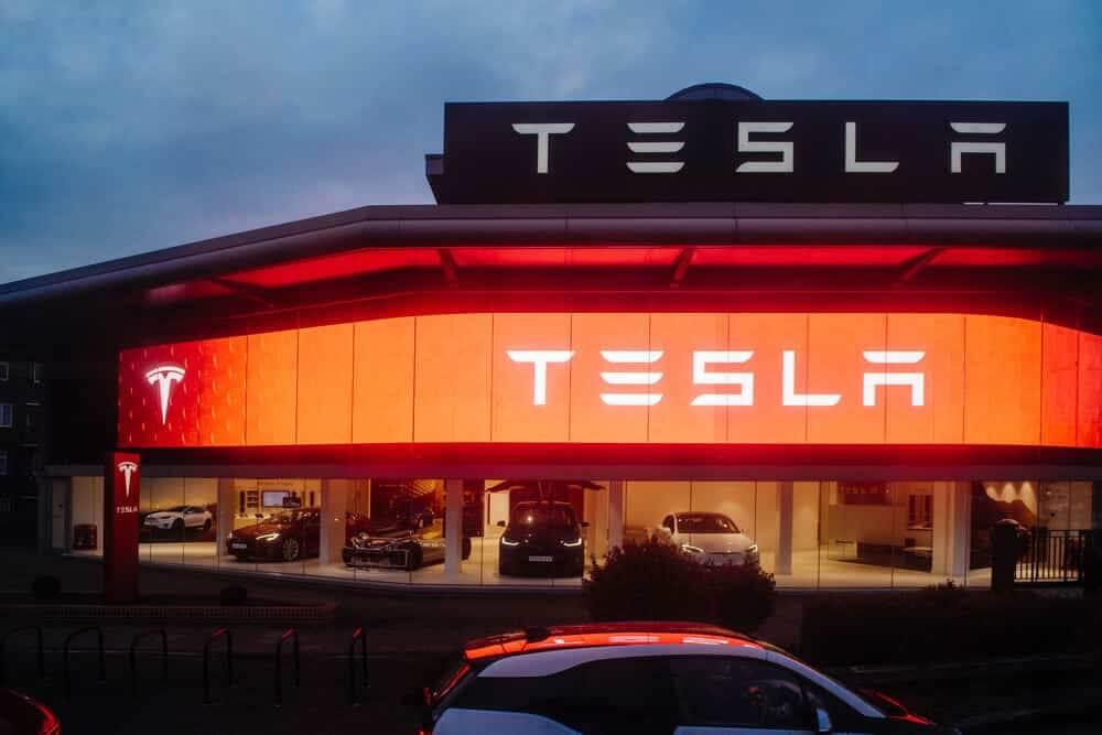 Tesla Motors showroom with multiple luxury Tesla cars inside.