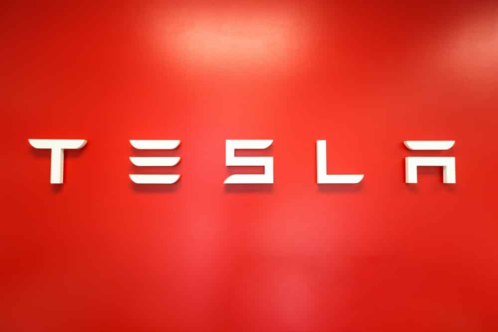 TESLA sign on the wall inside a Tesla store.