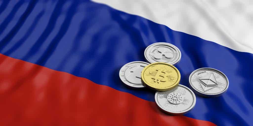 bandeira da russia com criptomoedas em cima