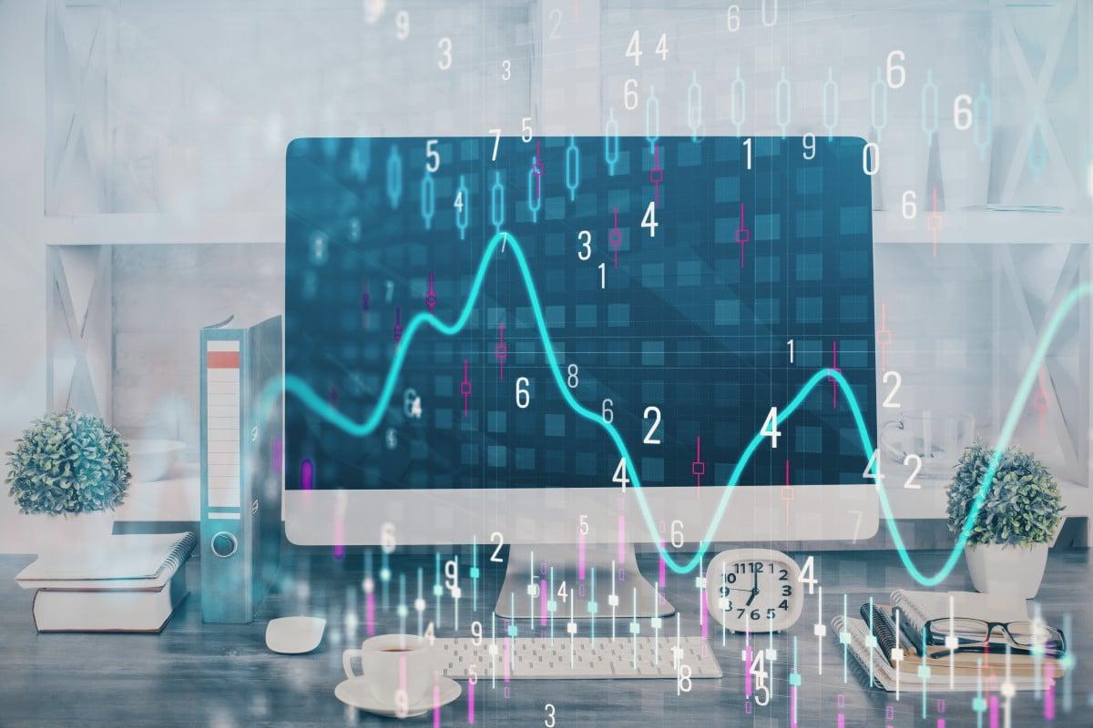 imagem de um monitor com grafico de acoes