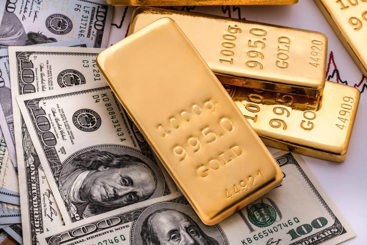 Gold fell as a stronger dollar made gold less appealing